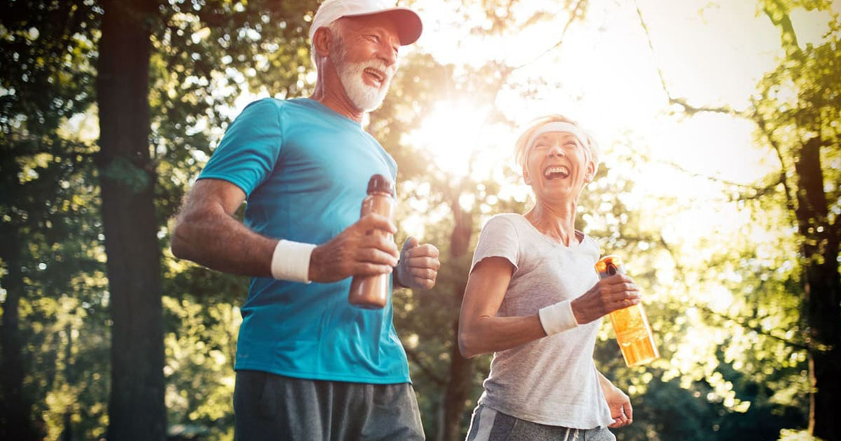 couple jogging - active adult St. Johns